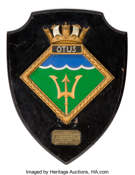The inscription on the plate says: Presented by the Lords of the Admiralty to Depwade R.D. to Commemorate the Adoption of HMS Otus During Warship Week February 21st 1942