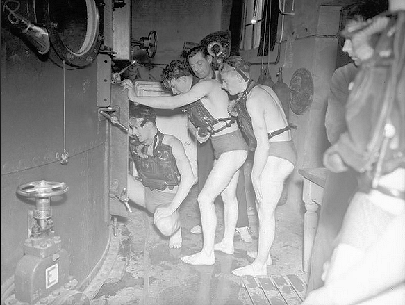 Trainees wearing DSEA waiting to enter the chamber within the 15ft tank (1942)