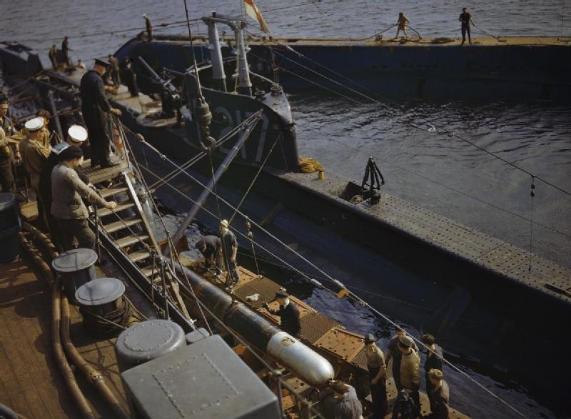Practice torpedo is loaded onto P311 at Holy Loch, Scotland, 1942 alongside HMS Forth