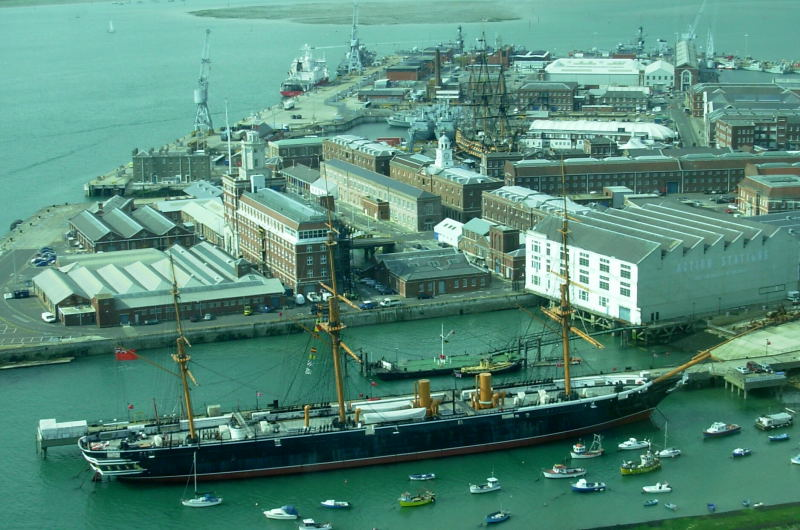 Portsmouth Dockyard seen from Spinnaker Tower. HMS Warrior in foreground, HMS Victory in distance