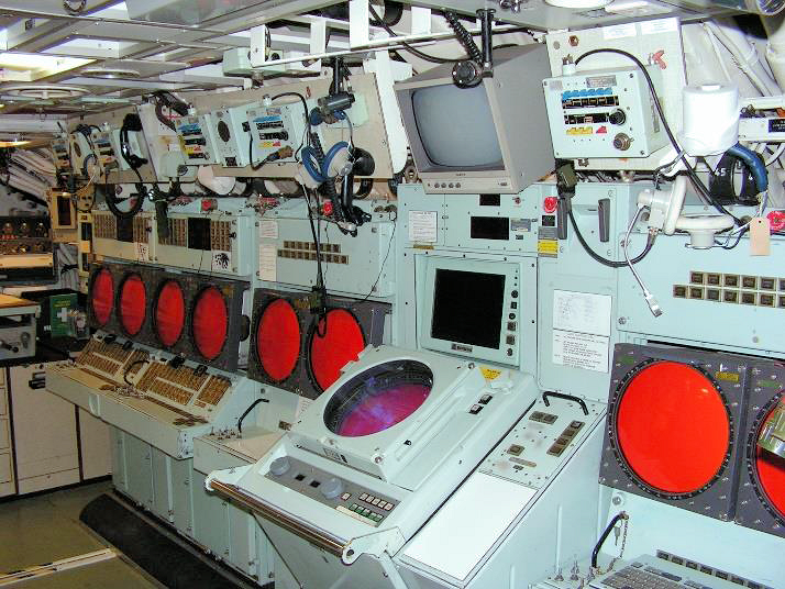 Either side of the PCO's console, standing out, are the TMA consoles. The two fire control consoles with their double screens are furthest away