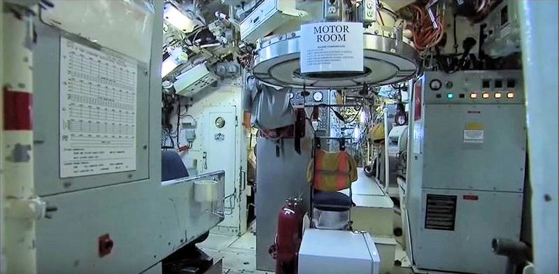 Fig 9c. Victoria Class Motor Room. The white circle in the center, visible just below the escape tower is the tachometer on the panel of the T2400 Propulsion Switchboard, aft over the Main Motor